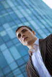 Young Businessman. In front of a glass office building Royalty Free Stock Images