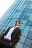 Young Businessman. In front of a glass office building Stock Photo