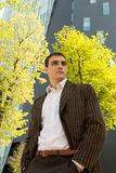 Young Businessman. In front of an office building in spring season Royalty Free Stock Image