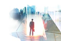 Success and opportunity concept. Young businessman on abstract city background. Success and opportunity concept. Double exposure Stock Photos