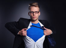 Young businessman acting like a super hero and Stock Photos