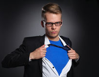 Young businessman acting like a super hero and Stock Photography