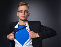 Young businessman acting like a super hero and Stock Image