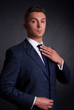 Young businessman adjusting his tie Stock Photo