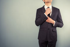 Young businessman adjusting his tie Royalty Free Stock Image