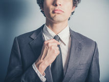 Young businessman adjusting his tie Stock Images