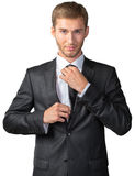 Young  businessman adjusting his tie Stock Photography