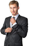 Young  businessman adjusting his tie Stock Photos