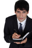 Young businessman with agenda Stock Image