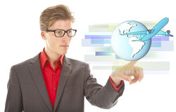 Young businessman with airplane and globe Stock Photo