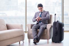 The young businessman in airport business lounge waiting for flight
