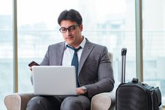 The young businessman in airport business lounge waiting for flight. Young businessman in airport business lounge waiting for flight Royalty Free Stock Images