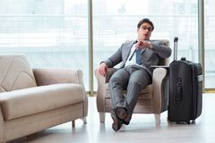 The young businessman in airport business lounge waiting for flight. Young businessman in airport business lounge waiting for flight Royalty Free Stock Photos
