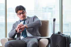 The young businessman in airport business lounge waiting for flight. Young businessman in airport business lounge waiting for flight Royalty Free Stock Image