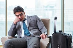 The young businessman in airport business lounge waiting for flight. Young businessman in airport business lounge waiting for flight Stock Photo