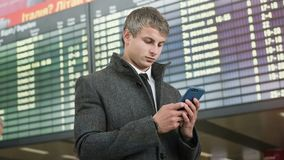Portrait of handsome business man using smartphone. royalty free stock images