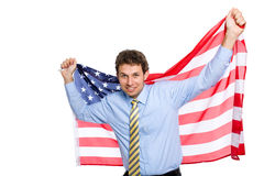 Young businessman with american flag, isolated Royalty Free Stock Images