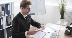 Businessman analysing documents at office