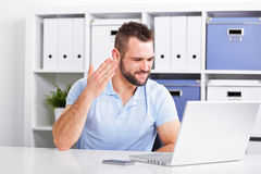 Young businessman is angry while working Stock Photography