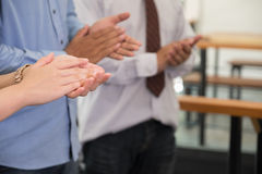Young businessman applauding to speaker after seminar presentati. On. start up business partners clapping hands after work meeting Stock Photography