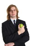 Young businessman with apple. Half body portrait of handsome young businessman with ripe green apple, isolated on white background Royalty Free Stock Images