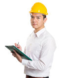 Young businessman architect writing on clipboard Royalty Free Stock Images