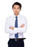 Young businessman armed crossed Stock Photography