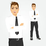 Young businessman with arms folded Stock Photos