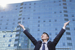 Young Businessman with arms raised Stock Photography