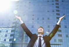Young Businessman with arms raised Stock Images