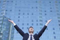 Young Businessman with arms raised Royalty Free Stock Photo