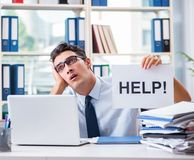 Young businessman asking for help in office