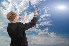 Young businessman asks from sun of success. Stock Images