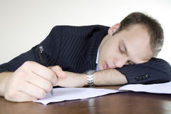 Young businessman asleep at his desktop Stock Photos
