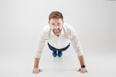 Young businessman with beard ready to work in career. man doing. Young businessman with beard in white shirt ready to work in a career. the man doing push ups on royalty free stock photo
