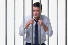 The young businessman behind the bars in prison Stock Photo