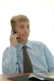 Young businessman behind work. Stock Photos
