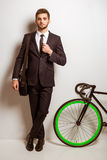 Young businessman with bicycle Stock Photography