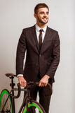 Young businessman with bicycle Royalty Free Stock Image