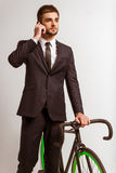 Young businessman with bicycle Stock Image