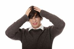 Young businessman with a big headache or problem. Royalty Free Stock Image