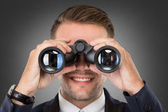 Young businessman with a binocular Royalty Free Stock Images