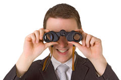 Young businessman with binoculars Stock Photos