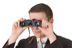 Young businessman with binoculars Stock Image