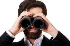 Young businessman with binoculars. Stock Photos