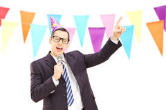 Young businessman with birthday hat singing at a party Stock Image