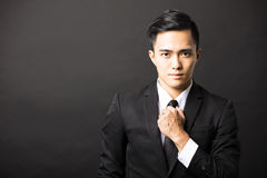 Young businessman on black background Royalty Free Stock Photo