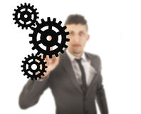 Young businessman with black gears isolated Stock Images
