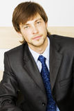 Young businessman in black suit Stock Image