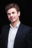 Young businessman black suit Stock Photos